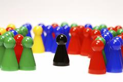 chinese checker figures are excluding a black token - stock photo
