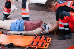 Stock Photo of emergency service taking woman