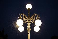 old street lamp with mosquitoes - stock photo