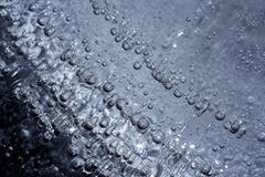 macro, airbubbles encapsulated in ice - stock photo