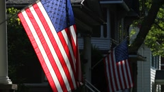 Stock Video Footage of American Flags outside houses in a small town, morning
