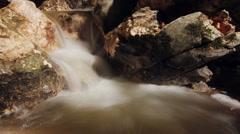 Waterfall into traquill pool HD Stock Footage