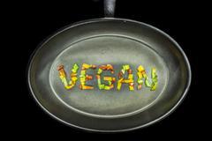 vegan word on a pan - stock photo