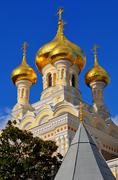 gold onion domes of the alexander nevsky cathedral - stock photo