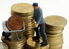 symbolic for salary of building worker - stock photo