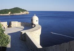 dubrovnik south dalmatia croatia from the city wall to lokrum island - stock photo
