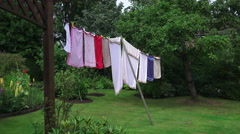 Zoom in to clothes washing hanging on a line in the garden, england Stock Footage