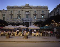 Stock Photo of malta valletta queens spare with cafe cordinana in front of the national libr