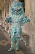 Turquoise mask under arcades, carneval in venice, italy Stock Photos