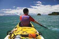 kayaker, abel tasman national park, south island, new zealand, oceania - stock photo