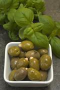 Almond filled olives with basil (ocimum basilicum) Stock Photos