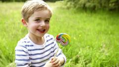 Little Boy Eating Big Lollipop Stock Footage