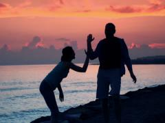 Couple jogging during beautiful sunset, super slow motion, 240fps NTSC Stock Footage