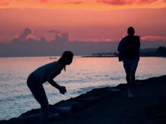 Successful couple of joggers by the see during sunset NTSC Stock Footage