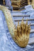 Mythological fiveheaded snake naga at the entrance of hor phra gandhararat pa Stock Photos