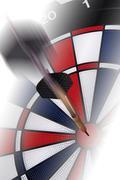 A dart hitting its target: symbol for bullseye Kuvituskuvat