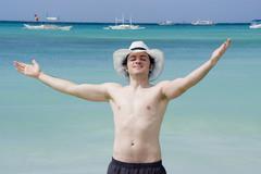 young man enjoying seaside - stock photo