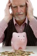 retiree with money troubles - stock photo