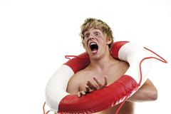 Stock Photo of young man with lifesaver