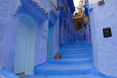 Luminous blue painted steep alley with stairs medina chefchaouen morocco Stock Photos