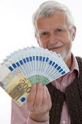 Retiree with money Stock Photos