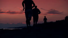 people jogging sunset sea back 240fps R K M v2 HD - stock footage