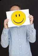 man with laughing smiley face - stock photo