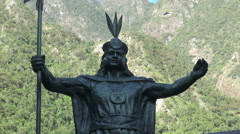 Peru Aguas Calientes Inca statue close up s - stock footage