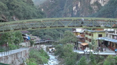 Peru Aguas Calientes bridge over stream s - stock footage