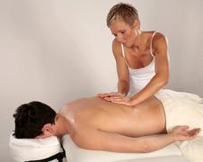 massaging back muscles - stock photo