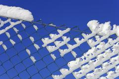 detail of a chain-link fence, covered with hoarfrost - stock photo