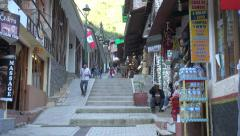 Peru Aguas Calientes shops along steep street s - stock footage