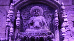 Buddha statue and fountain, purple filter Stock Footage