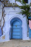 Luminous blue gate medina chefchaouen morocco Stock Photos