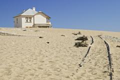 house in the former diamondtown (ghosttown) kolmanskop in the namib desert, l - stock photo