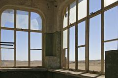 window in a house in the former diamondtown (ghosttown) kolmanskop in the nam - stock photo