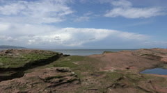 sandstone rock of hilbre island with view to irish sea, wirral, england - stock footage
