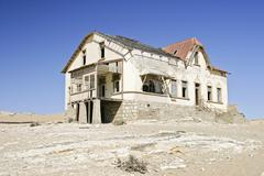 House in the former diamondtown (ghosttown) kolmanskop in the namib desert, l Stock Photos