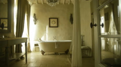 Bathroom interior with running water in the bathtub Stock Footage
