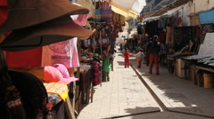 Peru Pisac market paved aisle crowded with wares 8 - stock footage