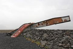 bent steel support from a bridge displaced by a glacial lake outburst flood ( - stock photo