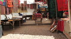 Peru Pisac market with fabrics and instruments 1 Stock Footage