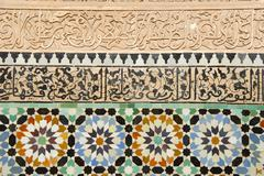 artful wall with colourful glazed tiles and stucco medersa ali ben youssef me - stock photo