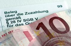 symbolic photo, receipt for ten euro additional payment, ten euro bill - stock photo