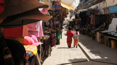 Peru Pisac market kids hold hands walking  9 Stock Footage