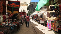Peru Pisac market shaded sidewalk and wares 3 - stock footage