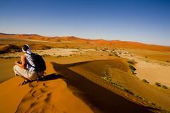 Woman on a sand dune, sossusvlei, namibia, africa Kuvituskuvat