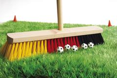 Broom in german national colours and little footballs: symbol for grand final Stock Photos