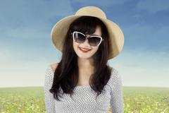 attractive young woman on the meadow - stock photo