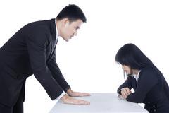 Businessman bullying his subordinate Stock Photos